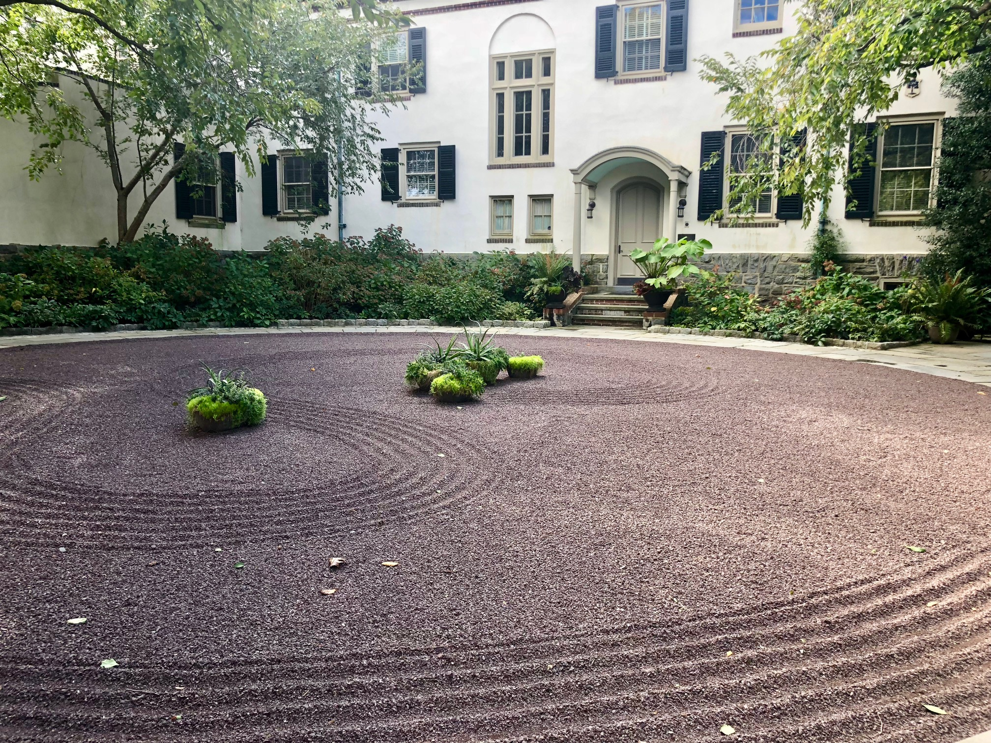 Decorative racked gravel courtyard garden at Chanticleer. More at Thinking Outside the Boxwood