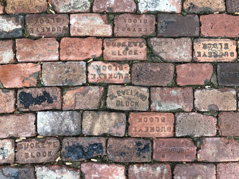 Historic Reclaimed Brick Paving using mix matched patterns. Thinking Outside the Boxwood